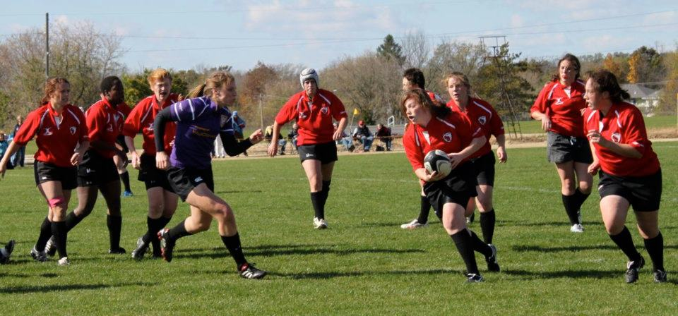 Wisconsin prop Jackie Neubert attacks down field against Palmer's defense.
