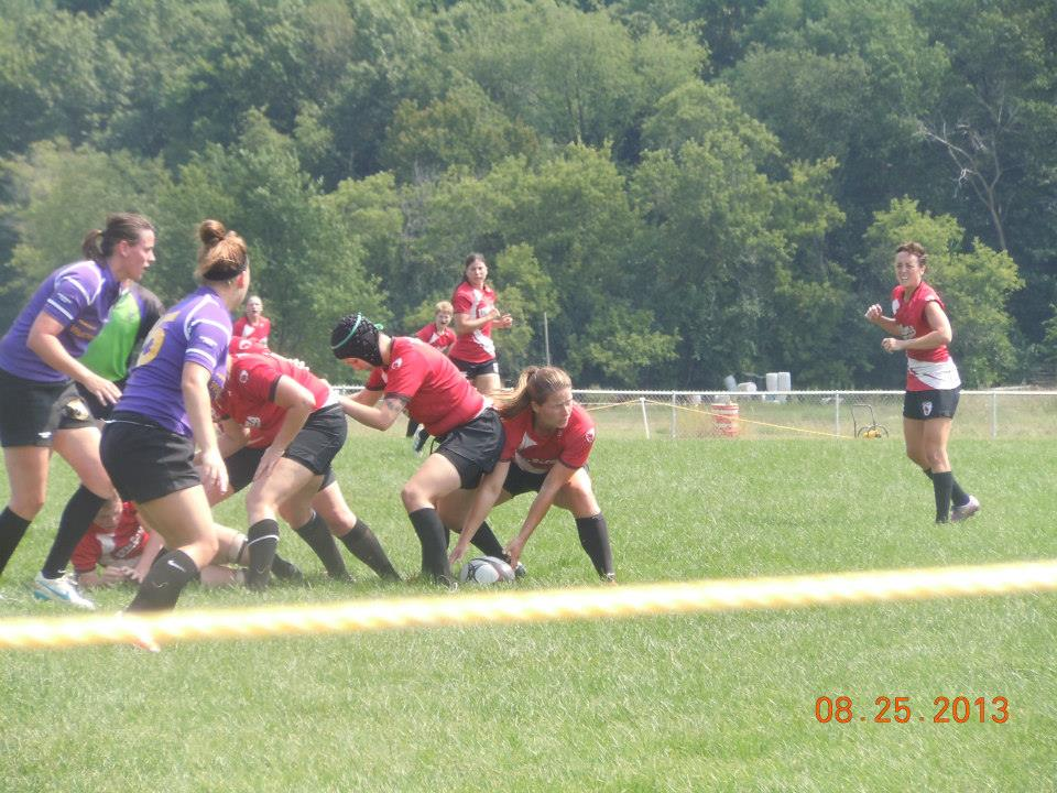 Scrumhalf Mary Hanks prepares to pass the ball from the base of a ruck won by Wisconsin.