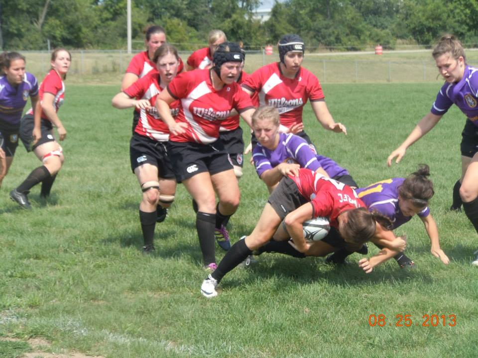 Wing Jenny Messer is tackled by the Palmer defense with support on the way from her teammates.