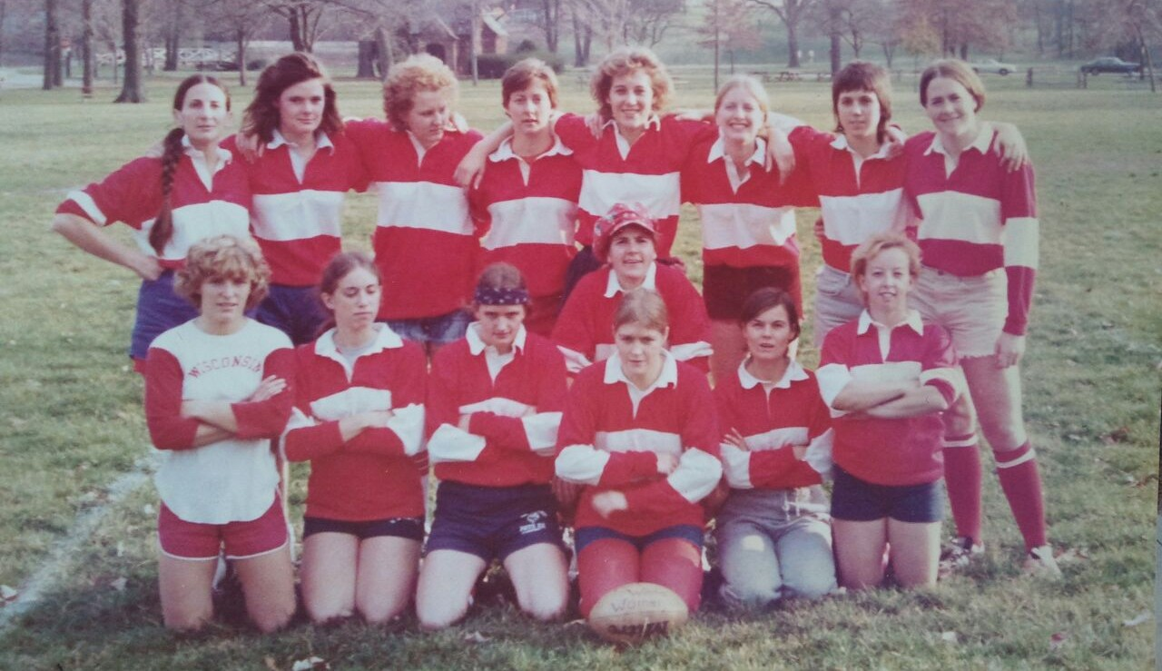 "The first-ever team photo of the Wisconsin Women's Rugby Football Club at a tournament in Indiana in the spring of 1976. Thank you to alumni Nancy ""Red"" Thorne Cahill for sharing this with our team."
