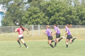 Wisconsin's Inside Center Nicole Helmer breaks away from the Palmer defense to run in a try.