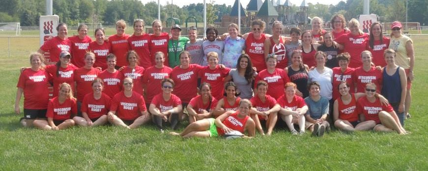 "The Wisconsin Women and UW Women, along with original team alum Nancy ""Red"" Thorne Cahill, August 24, 2013."