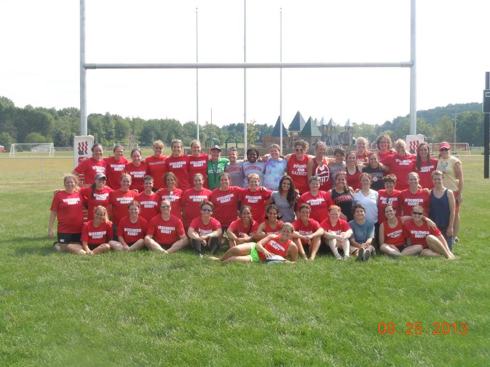 """The Wisconsin Women and UW Women, along with original team alum Nancy """"Red"""" Thorne Cahill, August 24, 2013."""