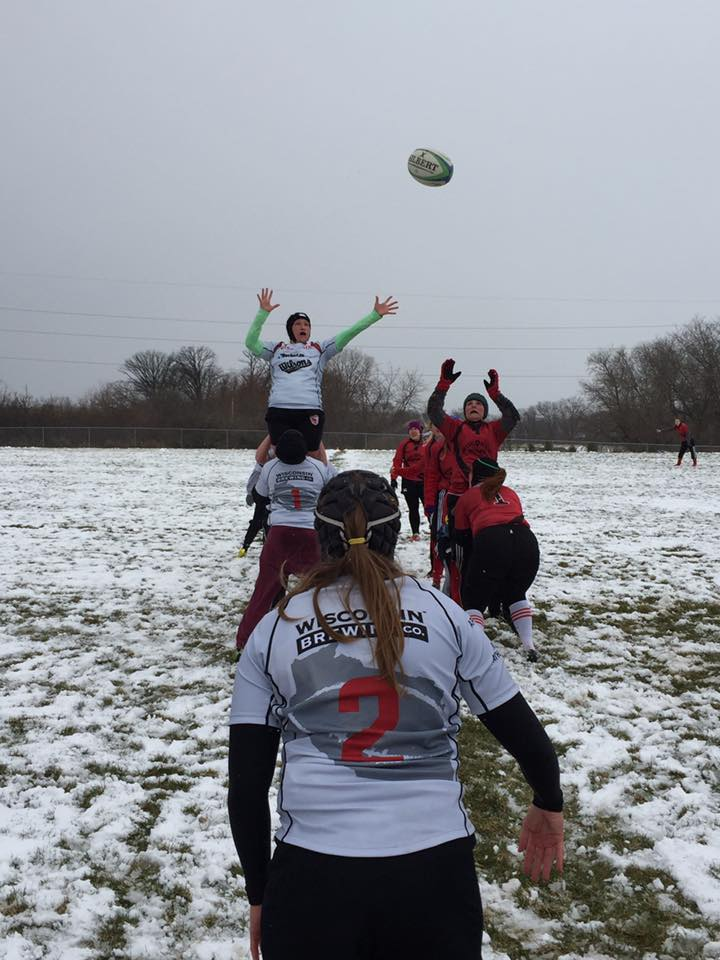 Wisconsin flanker/lock Sammy Clevenger goes up for the ball in a snowy lineout against UW-Madison.